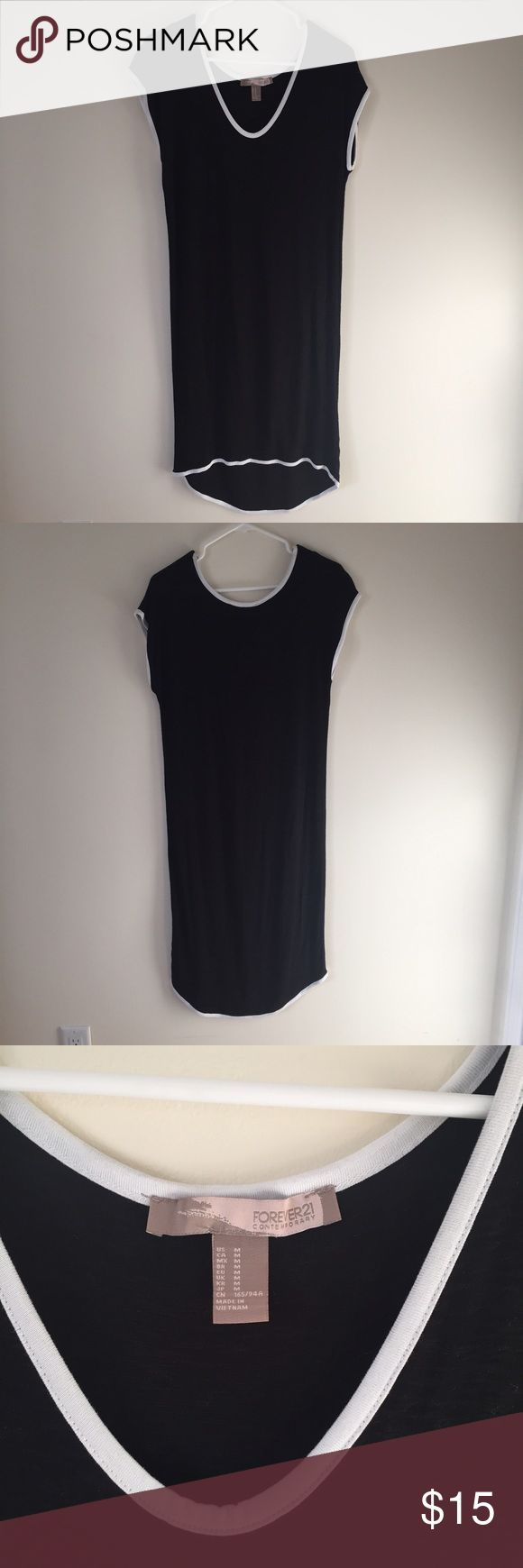 """Black sporty midi t-shirt dress Forever 21 Contemporary. Black with white piping. Casual and comfortable. Only worn once. Front comes down to my knees, the back is a little longer (I'm 5'6""""). Really cute with sneakers, and great for layering. Only worn once, in perfect condition!!! Make me an offer 😊💜 Forever 21 Dresses Midi"""