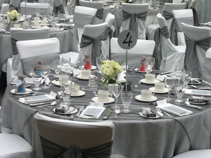 Grey Organza wedding table linen overlays, sashes and decor...get silver organza table overlays and garland at alwayselegant.com