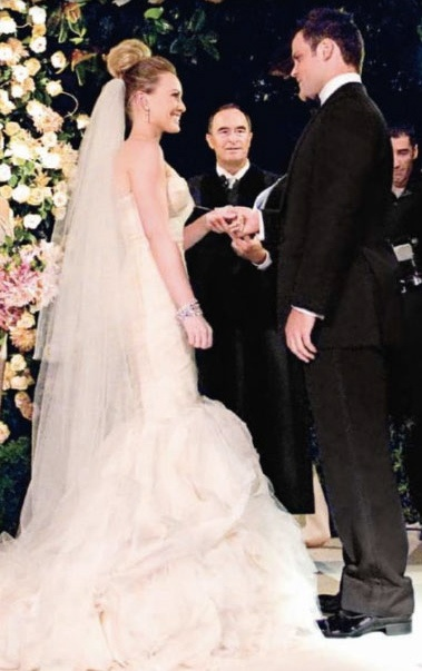 Hillary Duff wore a stunning custom Vera Wang mermaid gown for her wedding to Mike Comrie on August 14th, 2010 in Santa Barbara, California. Vera later added this dress to her line--the style is Gemma. Vera Wang gowns are sold at The Bridal Salon at Saks Jandel.
