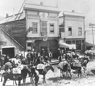 Gold seekers thronging Dawson City, Yukon Territory, Canada, during the gold rush of the 1890s.
