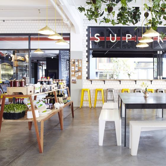 Vibrant+and+incredibly+stylish,+the+space+is+like+a+ray+of+sunshine;+old-fashioned+subway+tiles+set+the+backdrop,+untreated+wood+and+powder-coated+yolk-yellow+metal+chairs+allow+for+the+hanging+plants+and+chosen+products+to+shine+through...