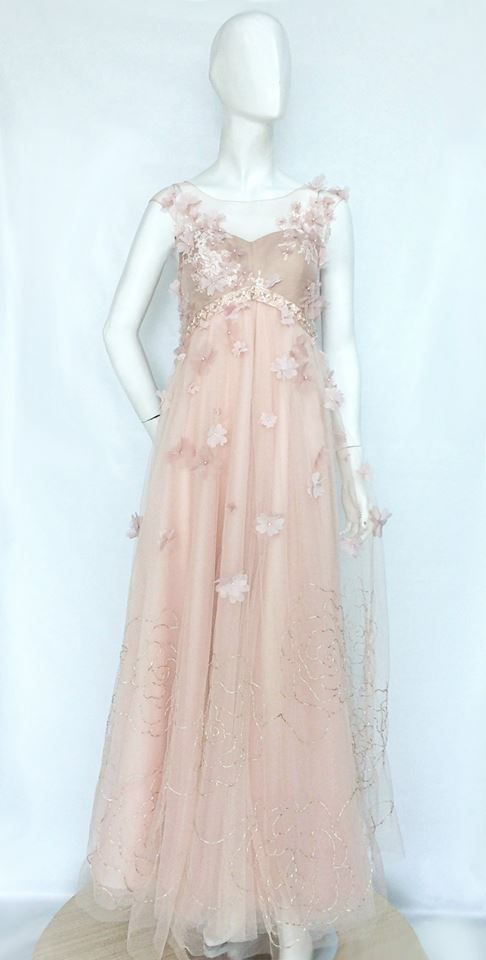 Mien Gown. The blush colored tulle gown is a picture of beautiful romance. Silk organza flowers decorates this enchanting design, perfectly combined with hand beaded rose pattern embroidery.  For pricing, sizing, and ordering details please email us at nmayinda@gmail.com, Whatsapp us at 081299331039, or BB us at 2B07B968.