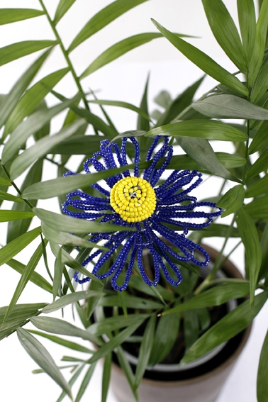 Add colour to boring pot plants with handcrafted flowers from www.wiredandwonderful.com.au African homewares and gifts, $15 (free delivery in Australia).