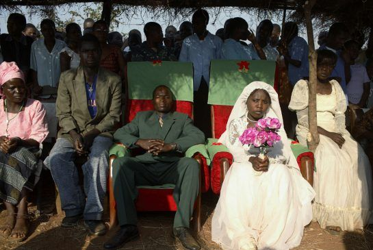 A Malawian traditional leader has taken it upon herself to discourage the prevalence of child marriages within her constituency. image: A 16 year-old Malawian girl  during her wedding to what appears to be a grown man. Photo: Per Anders Petterssen/Getty