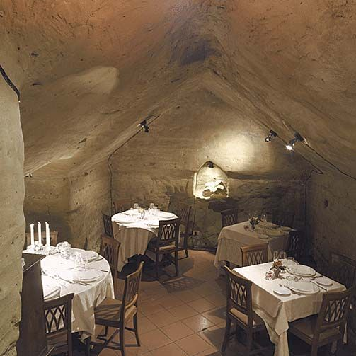 Antica Osteria Da Divo ~ Siena, Italy.| A wonderful restaurant in a fantastic setting just down the street from the Duom'as baptistry. The risotto served from inside a wheel of cheese is just one choice for the beginning of a wonderful meal here!