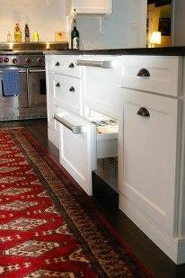 Wellborn Cabinets Showing Custom Door Panels Over A Refrigerator Drawer