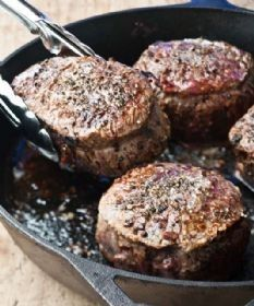 """Barefoot Contessa's { Steakhouse Steaks } """"...when the skillet is ready, add the steaks and sear them evenly on all sides for about 2 minutes per side, for a total of 10 minutes. Top each steak with a tablespoon of butter and place the skillet in the oven. Cook the steaks about 8 minutes at 400 degrees... Allow to rest at room temperature for 10 minutes."""" BEST STEAKS EVER."""