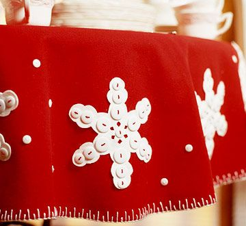 Felt Snowflake Tablecloth    Wrap your table in red and white with a felt tablecloth featuring button-accented snowflake cutouts and contrasting blanket stitches on the trim.