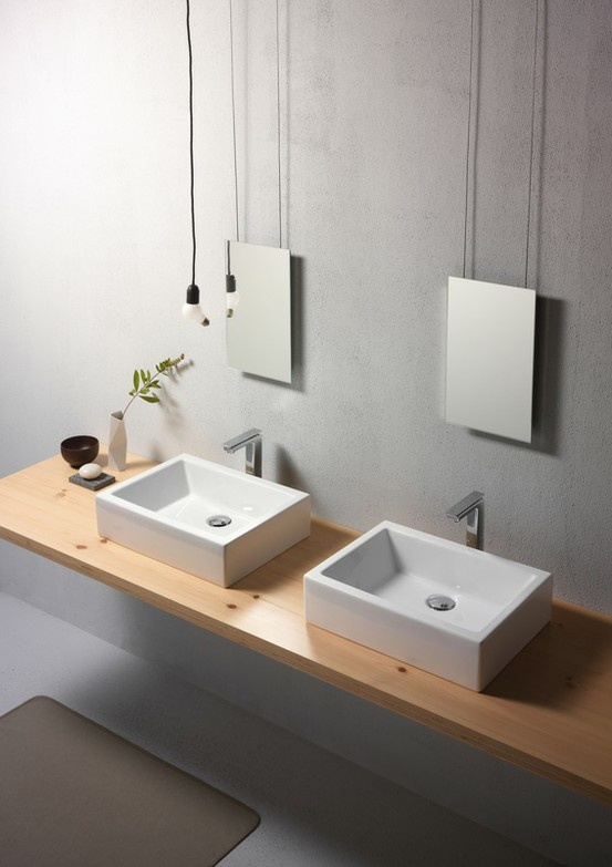 GSI ceramic | KUBE 50/T is a countertop washbasin glazed on all the visible surfaces. A washbasin that thanks to its clean lines without an overflow tap and a versatile tap system can be combined with any type of bathroom style.