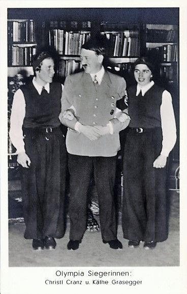 A rare photo of Hitler inside his Munich apartment at #16 Prinzregentenplatz with two German athletes in 1936. This is the room where Hitler seduced a number of young women, at least Eva Braun and Mimi Reiter. (via putschgirl)