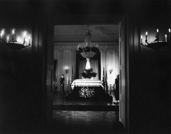 The Funeral of JFK ~   President Kennedy's casket lies in state in the East Room of the White House, attended by two members of the honor guard, 23 November 1963.
