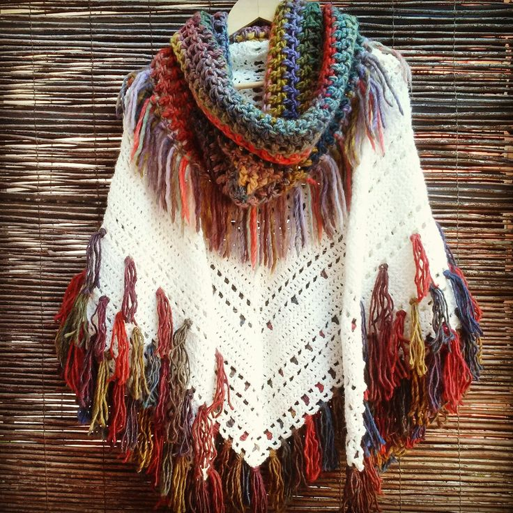 This is a shawl but if I were going to make it, I'd do it as a poncho. I love the many rows of fringe! Really gorgeous. Maybe I'll make the scarf with fringe first, that's fabulous in and of itself! Bo-M