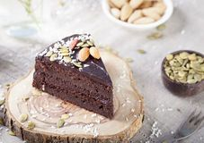 Vegan chocolate beet cake with avocado frosting, decorated nuts, seeds Royalty Free Stock Photography