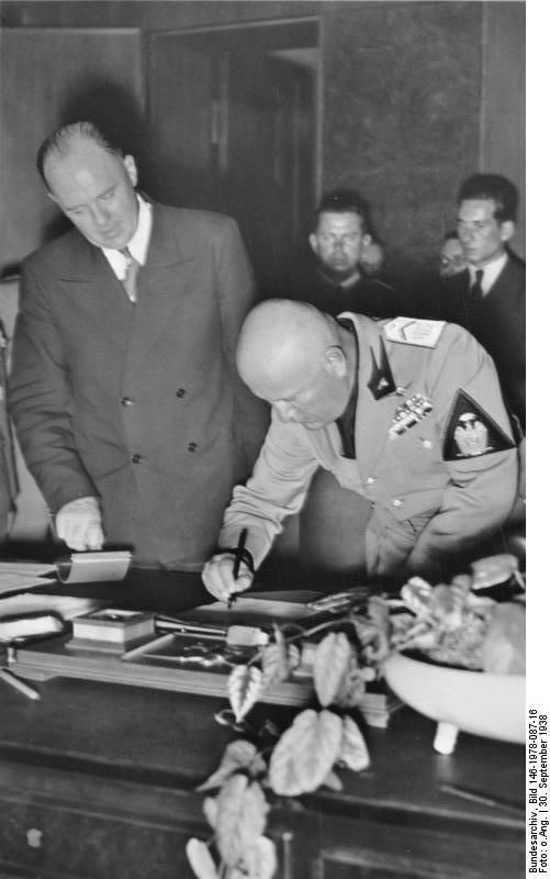 Benito Mussolini signing the Munich Agreement, Germany, 30 Sep 1938, photo 2 of 2
