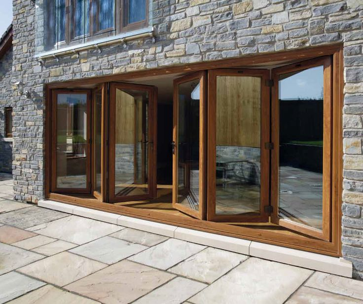 Gorgeous wooden bi fold doors home improvement for Folding patio glass doors