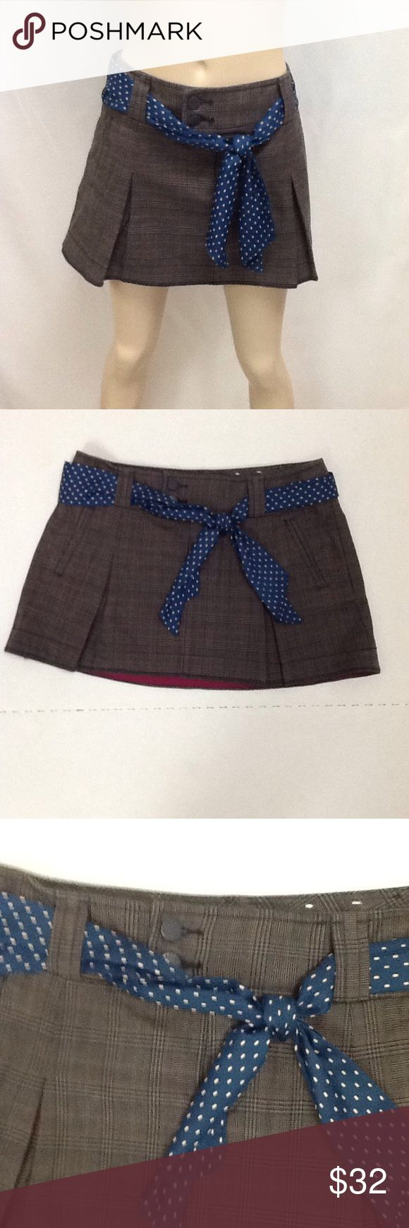 Size 6 Schoolgirl Skirt American Eagle Plaid Front and back pockets, pleats and sash adorn this plaid schoolgirl skirt  by American Eagle Outfitters. Button and zipper front. 100% cotton. American Eagle Outfitters Skirts Mini