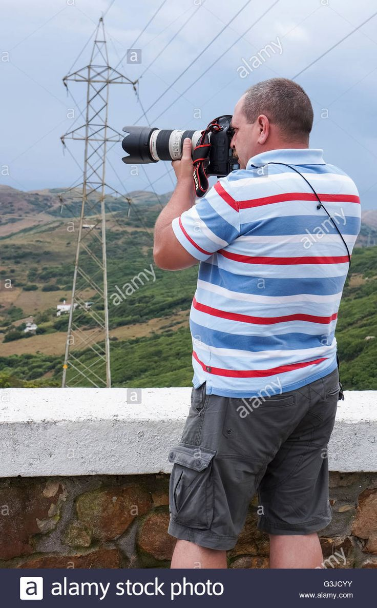 Download this stock image: photographer at the Strait of Gibraltar, Spain - G3JCYY from Alamy's library of millions of high resolution stock photos, illustrations and vectors.