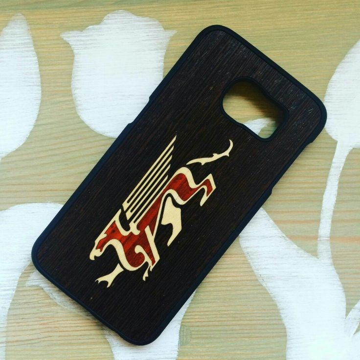 Dragon design on your phone case. It is produced from 3 different types of wood. Looks really attractive and it is Nice to touch