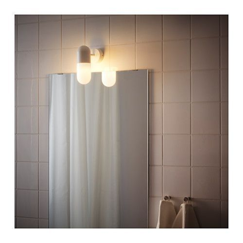 IKEA ÖSTANÅ wall lamp Provides an even light that is good for illuminating around a mirror and sink.