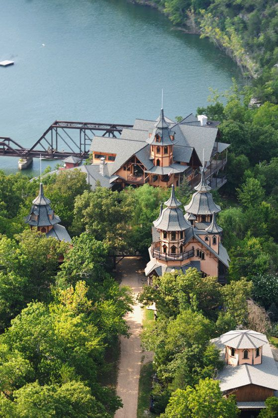 Rogues Castle, Eureka Springs, Arkansas. This 15,000 square foot fantasy medieval style castle took 16 years to design and build. It is set on the wooded shores of Table Rock Lake and is open for tours and special event rentals. It's an amazing piece of architecture!