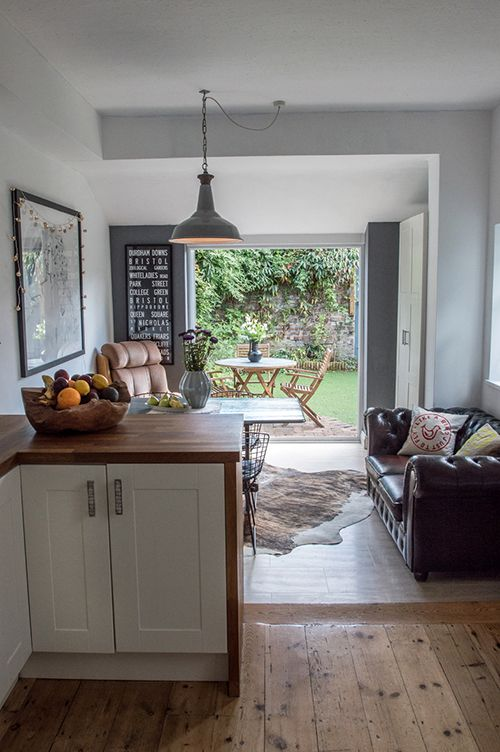 Lovely open plan kitchen - love the french doors thrown open to the garden