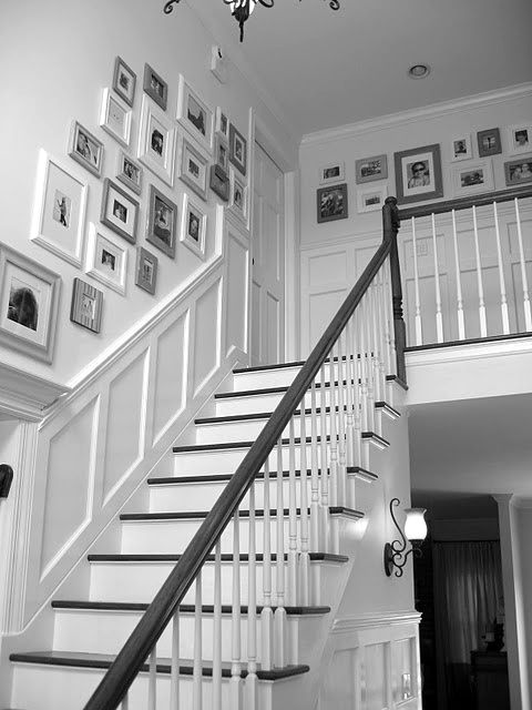 Picture wall and wainscoting up the stairwell