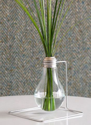 Lightbulb Bud Vase : ReadyMade's lightbulb bud vase is an afternoon craft perfect for those who already have DIY staples like safety glasses, pliers, and an Allen wrench at home. Take an incandescent bulb (NOT fluorescent bulb, as those contain mercury), and follow ReadyMade's directions for a luminous living room accessory.