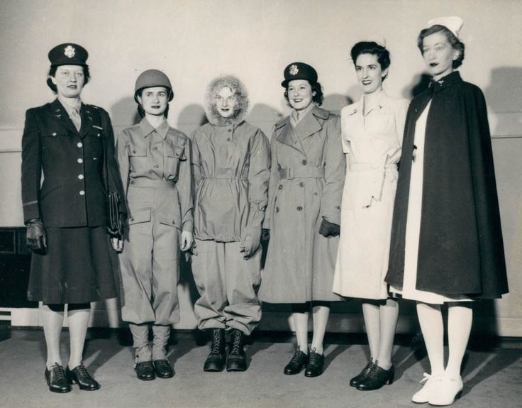 "It competes with the best of the uniforms of the other female members of Uncle Sam's forces. The nurses themselves call the uniforms the ""tops"". L. to R.: Helen Summers:models the street uniform;Mary Clarke:the field uniform;Eleanor Aldhizer:the field and street clothes for cold climates;Helen Rennie:street uniform with winter coat;Elizabeth Hunter:the field hospital outfit;Virginia Johnson:the hospital uniform and cape ~"