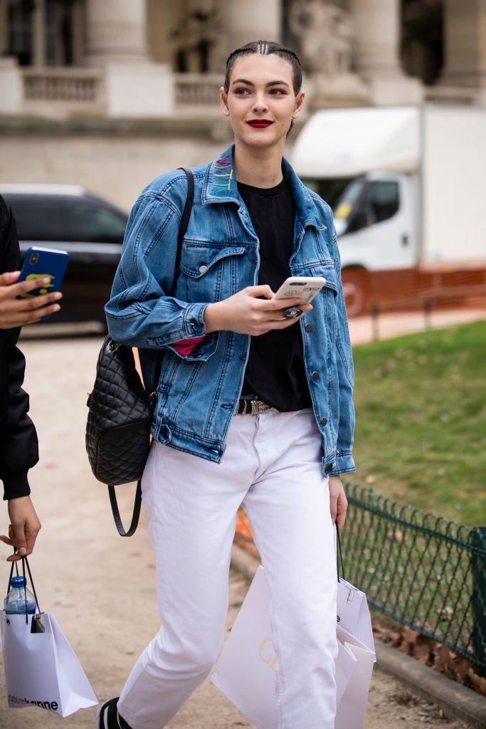Vittoria Ceretti Wearing A Black Top White Jeans Blue Denim Jacket Blue Denim Jacket Black Tops White Jeans