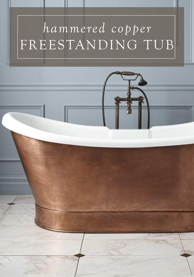 This elegant freestanding copper bathtub will be the perfect addition to your master bathroom makeover. Its eye-catching appearance is sure to add interest and sophistication to the space.