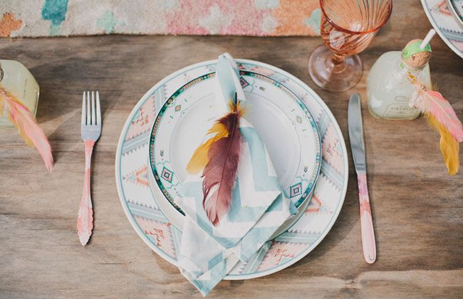 Southwestern/desert-inspired table setting with paint-dipped silverware and chevon + feather napkin.