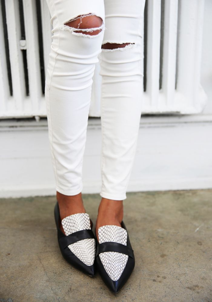 Ripped white jeans with Celine loafers.