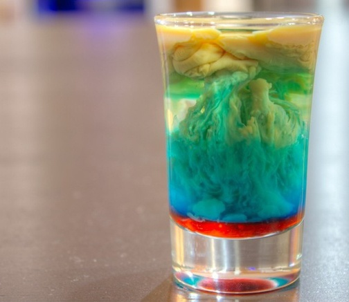 Alien Brain Hemorrhage Shot:    - Fill a shot glass 1/2 full with Peach Schnapps    - Layer in Bailey's Irish Cream leaving a little room at the top.    - Pour in a little bit of Blue Curacao    - Add a few drops of Grenadine Syrup and enjoy!