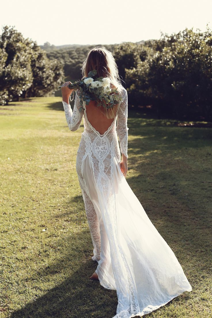 "Grace Loves Lace ""Inca"" wedding gown. Made with a combination of French and Japanese lace, this dress style with a statement plunging back is a true boho beauty // Bohemian brides inspiration {Facebook: The Wedding Scoop}"