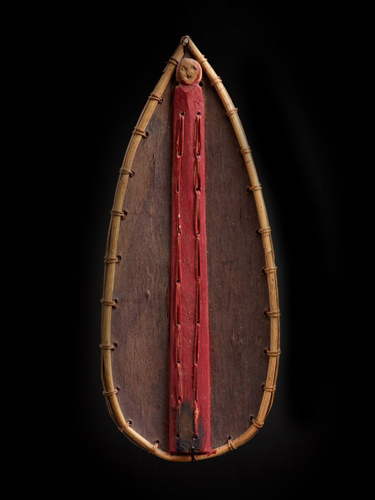 click to enlargeMiniature Shaman's Shield 10939 Bidayuh Dayak, Borneo Wood, pigment Early 20th Century 13 in/33 cm $3500 Red is the color of blood, which may be associated with life and death. This rare shield encorporates the color below a single head, perhaps an ancestor or alternativly a depiction of a tropy head taken in battle. This shield would be used by shaman's in psycho-spiritual battles with demons on the astral plane, hence its small size.