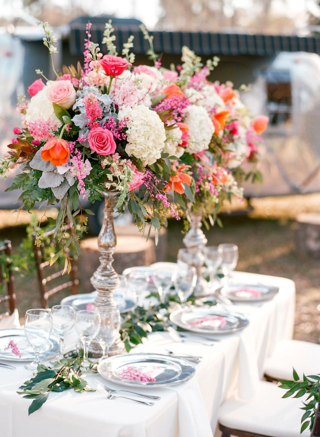 Tall, colorful floral centerpieces   Dana Fernandez Photography