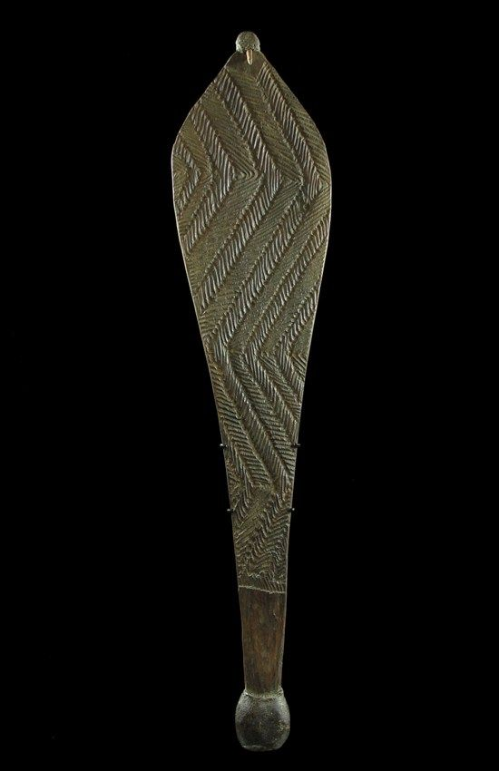 ABORIGINAL WOOMERA - This Western Australian spear thrower woomera is as great old example in perfect condition. The form is wide with a strong design done with outstanding precision considering it was done with non metal tools. The Spinifex resin handle and bone insert are both intact which is unusual in examples of this age. The back is very finely adzed. It would date to the 19th century and measures 62 cm