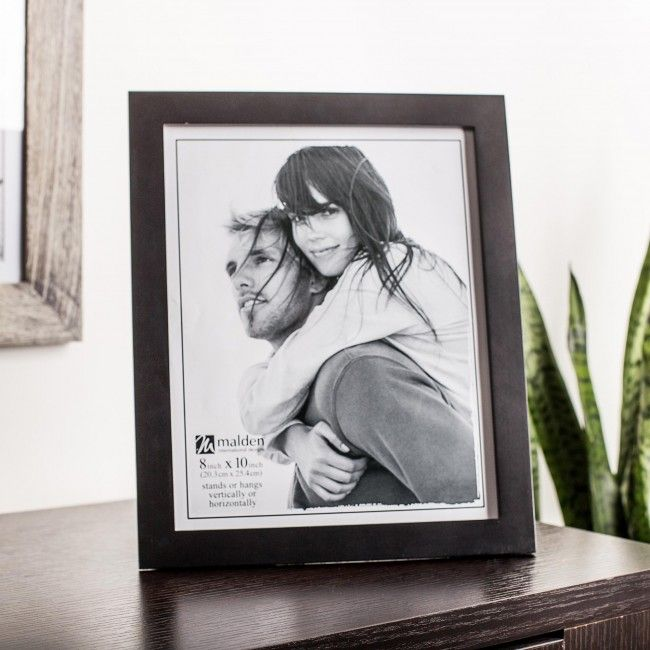 Display your favourite memories with a Malden Linear Woods Tabletop Wood Frame.