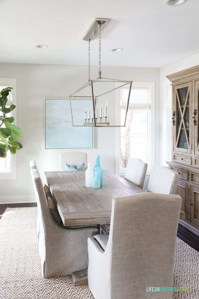 Coastal Dining Room With Natural Wood Table Linen Chairs Fiddle Leaf Fig Tree