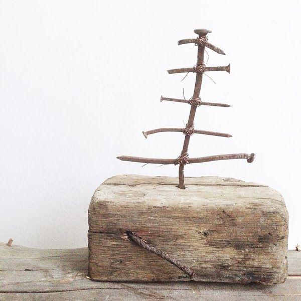 Rusty nails and wood. Tiny Christmas tree.