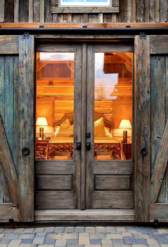 instead of french doors sliding barn doors for the home outer doors close to secure windowed doors off the bedroom which is a brilliant idea