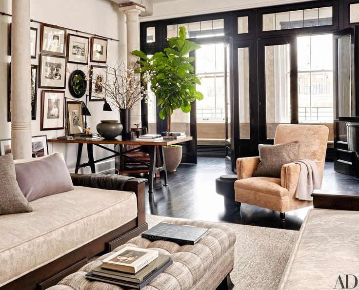 Light floods the living room, where a pair of task lamps from Wyeth sit atop a vintage worktable, one of Ryan's treasured finds. The armchair at right, also from her trove, is joined by a Stéphane Parmentier lava-stone stool.