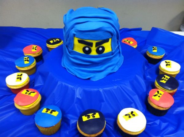 Ninjago Cupcakes with fondant masks and layer of yellow frosting underneath