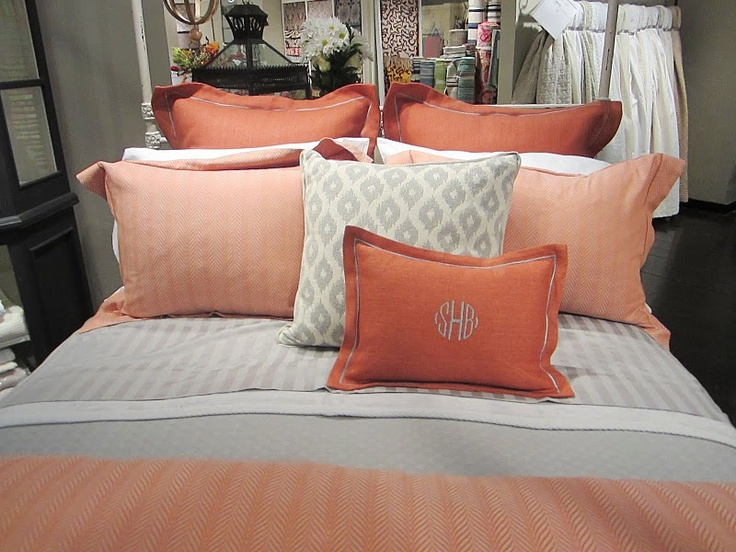 Pretty Coral and Gray bedding - wonder how it would look with my navy and blue-gray walls?