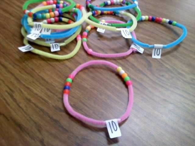 Number Bracelets!  Common Core way of thinking...taking numbers 'deeper'  piper cleaner, plastic beads, and shipping label: easy, cheap, and effective!