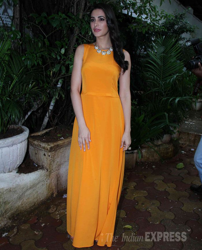 Nargis Fakhri in a stunning tangerine coloured DKNY maxi dress at the launch of home styling brand Portico New York's 'Mission Home Fashion' in Mumbai. #Style #Bollywood #Fashion #Beauty