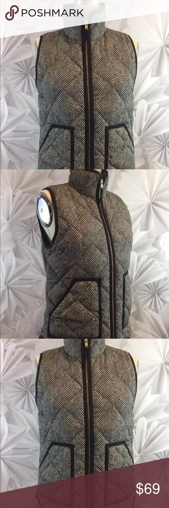 "J Crew Herringbone Down Vest Puffer Full Zip J Crew Herringbone Down Vest Puffer Womens Gray/Black Poly Sz XS Full Zip   Bust: 36 1/2"" Length: 25 1/4"" Sleeves: sleeveless    This garment is in excellent used condition. There are no stains, spots, pills or signs of wear.   This item comes from a smoke free pet free environment. Please follow us on our store and never miss another sale!  INCLUDES SPECIAL BONUS GIFT!!! J. Crew Jackets & Coats Puffers"