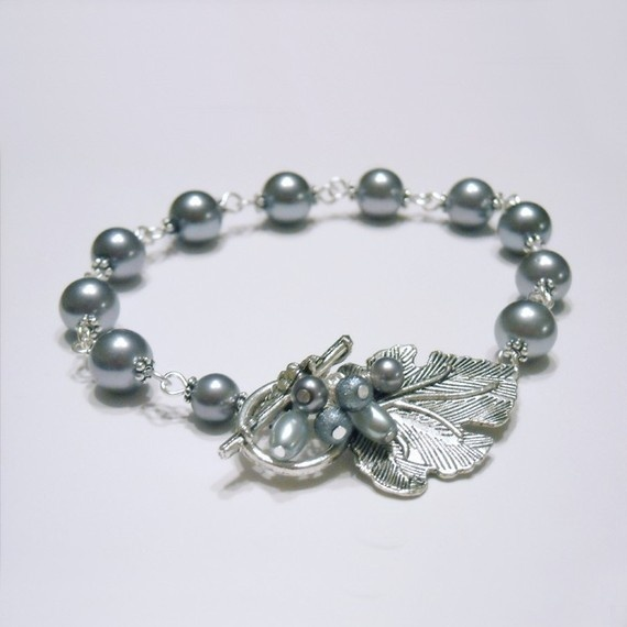 This nature-inspired bracelet features large grayish-blue pearls with an amazing luster shining beautifully next to a silver grape clasp with lots of details.  Get it here: http://etsy.me/15Of9rc