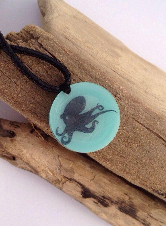 Octopus silhouette eco-resin pendant in aqua on vegan cord.