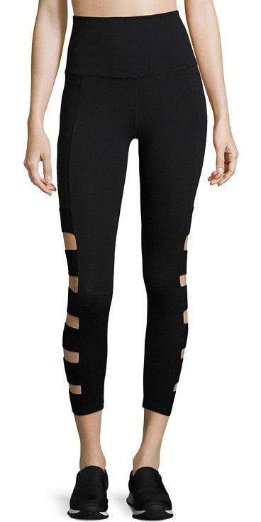 """wide band stacked capri leggings by Beyond Yoga. Stacked cutouts on a solid leggings offer unique style. Wide waistband. Pull-on style. Lined. Waistband, 3"""".Rise, abo..."""